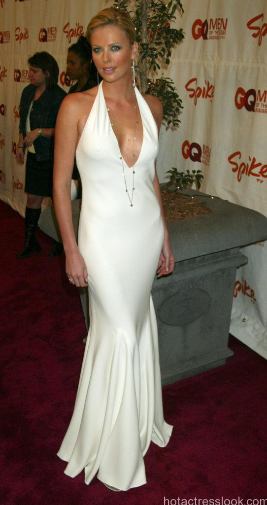 Charlize Theron, wearing a Ralph Lauren dress during Spike TV Presents 2003 GQ Men of the Year Awards - Arrivals at The Regent Wall Street in New York City, New York, United States. (Photo by Gregory Pace/FilmMagic)