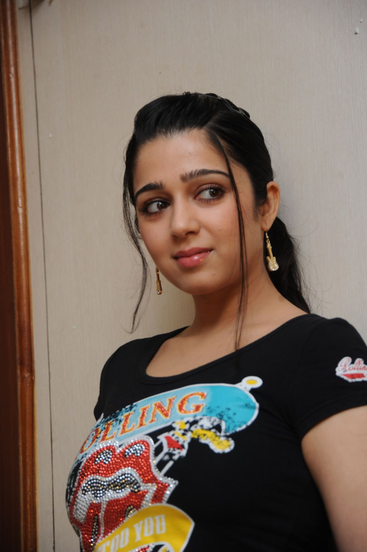 Charmi Kaur hot looking pics