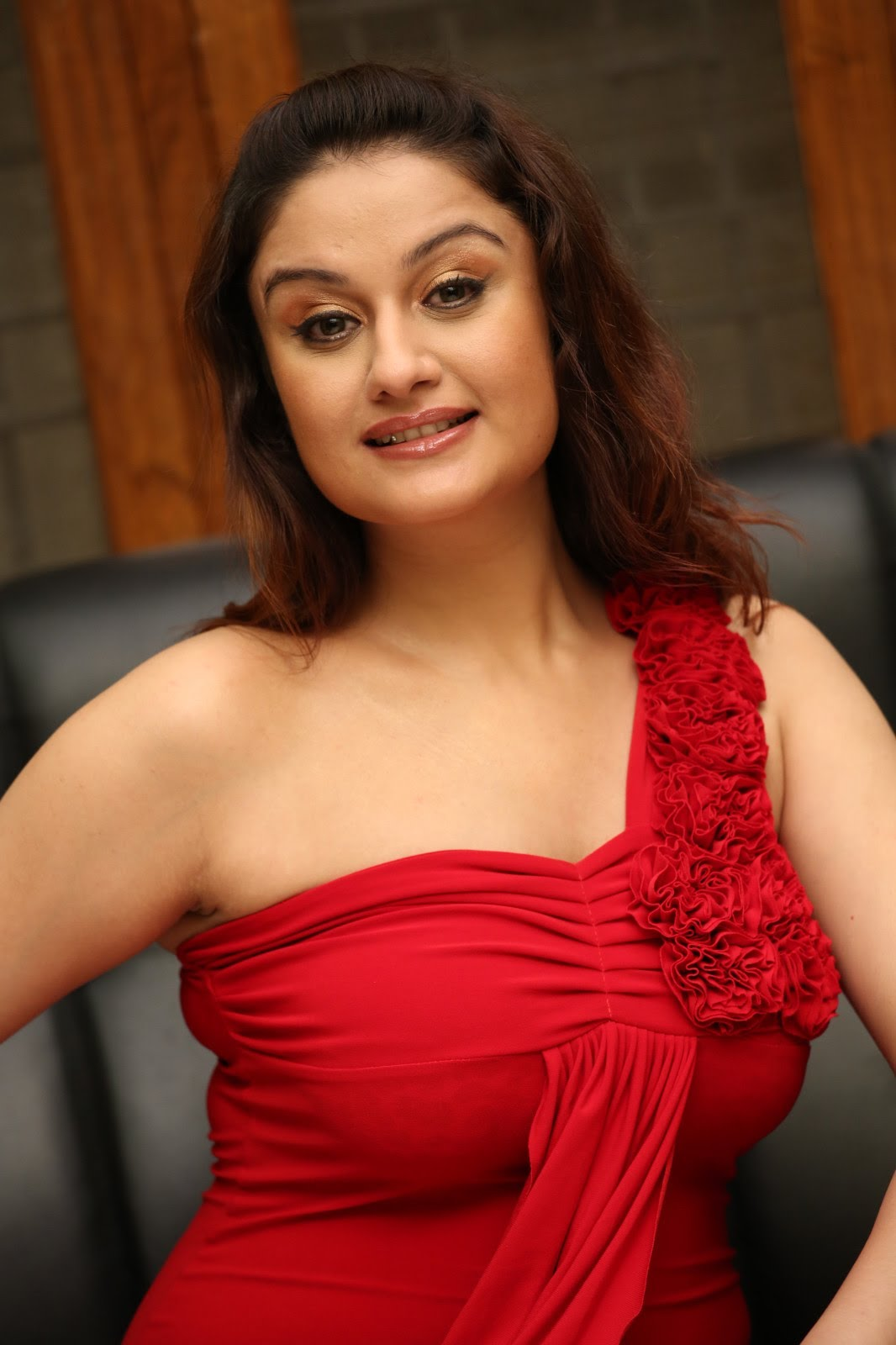 Sonia Agarwal hot in red bikini