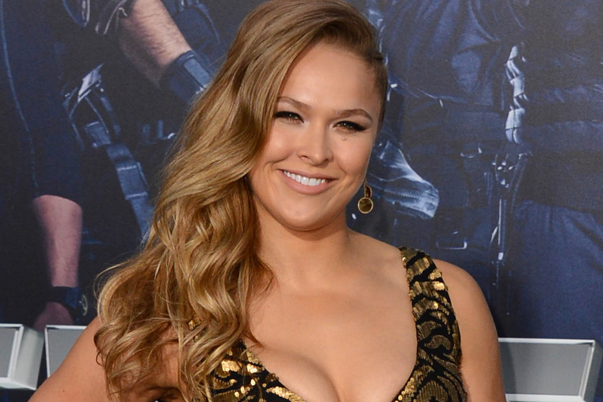 "Ronda Rousey arrives at the premiere of ""The Expendables 3"" at TCL Chinese Theatre on Monday, Aug. 11, 2014, in Los Angeles. (Photo by Jordan Strauss/Invision/AP)"
