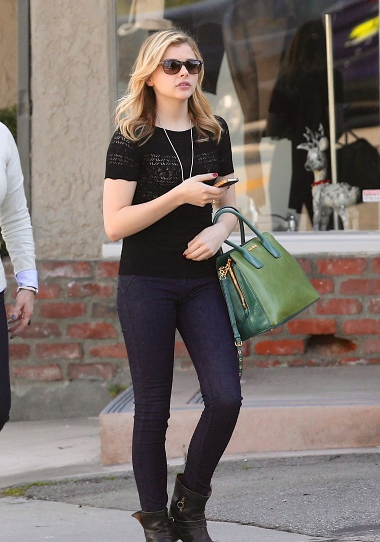 "88208, LOS ANGELES, CALIFORNIA - Tuesday December 11, 2012. Chloe Moretz goes out for sushi with her brother Trevor and mom Terri in West Hollywood. The 15 year old ""Kick Ass"" star was full of smiles as she walked down the street with her family. Photograph: ©PacificCoastNews.com **FEE MUST BE AGREED PRIOR TO USAGE** **E-TABLET/IPAD & MOBILE PHONE APP PUBLISHING REQUIRES ADDITIONAL FEES** LOS ANGELES OFFICE: 1 310 822 0419 LONDON OFFICE: +44 208 090 4079"