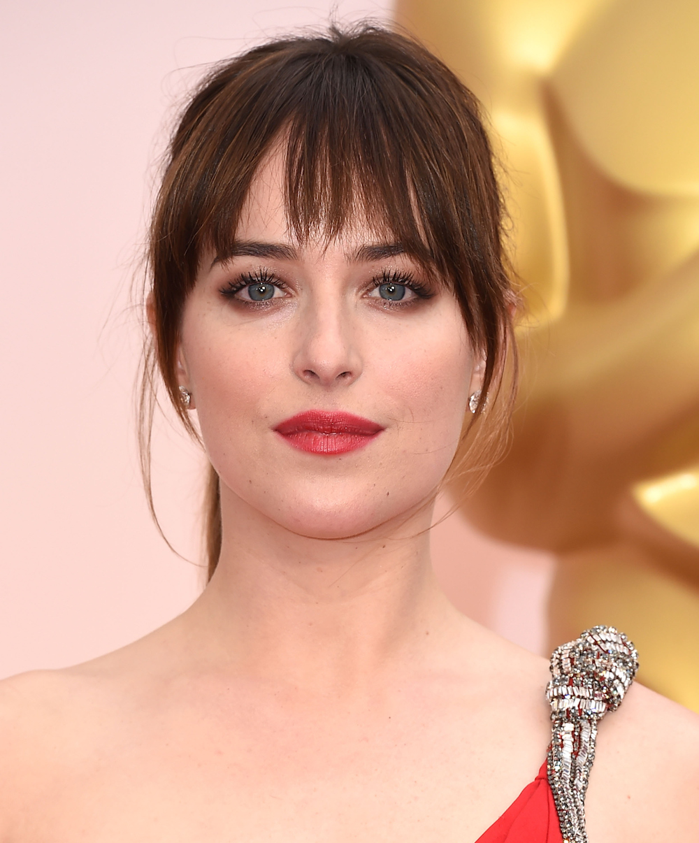 HOLLYWOOD, CA - FEBRUARY 22: Dakota Johnson arrives at the 87th Annual Academy Awards at Hollywood & Highland Center on February 22, 2015 in Hollywood, California. (Photo by Steve Granitz/WireImage)