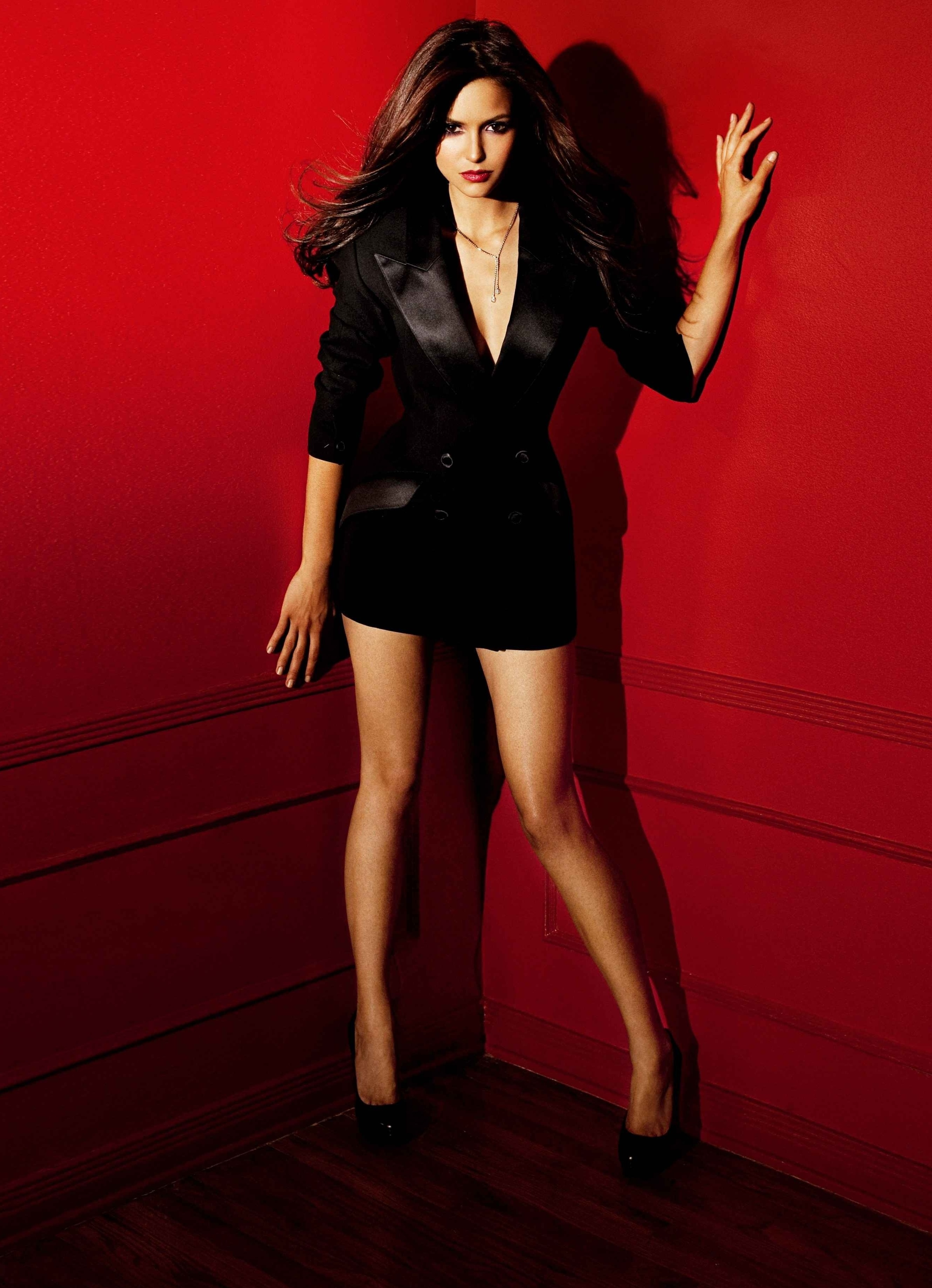 Model: Nina Dobrev Photographer: Jake Bailey Year: 2011 Clothes: Very short black dress with fishnet tights Shoes: High heels