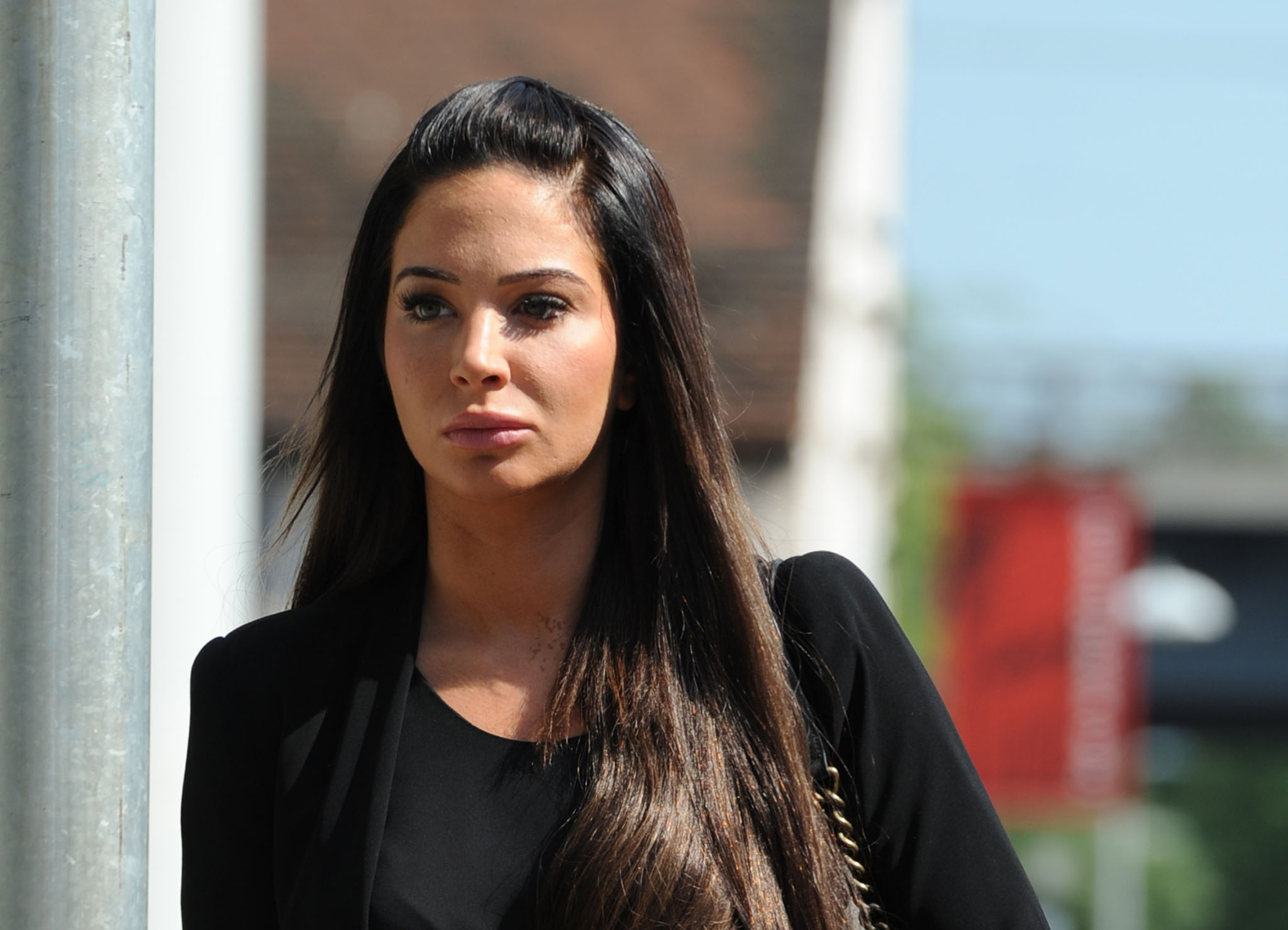 CHELMSFORD, ENGLAND - MAY 19: Tulisa Contostavlos arrives to face assault charges at Chelmsford Magistrates Court on May 19, 2014 in Chelmsford, England. (Photo by Stuart C. Wilson/Getty Images)