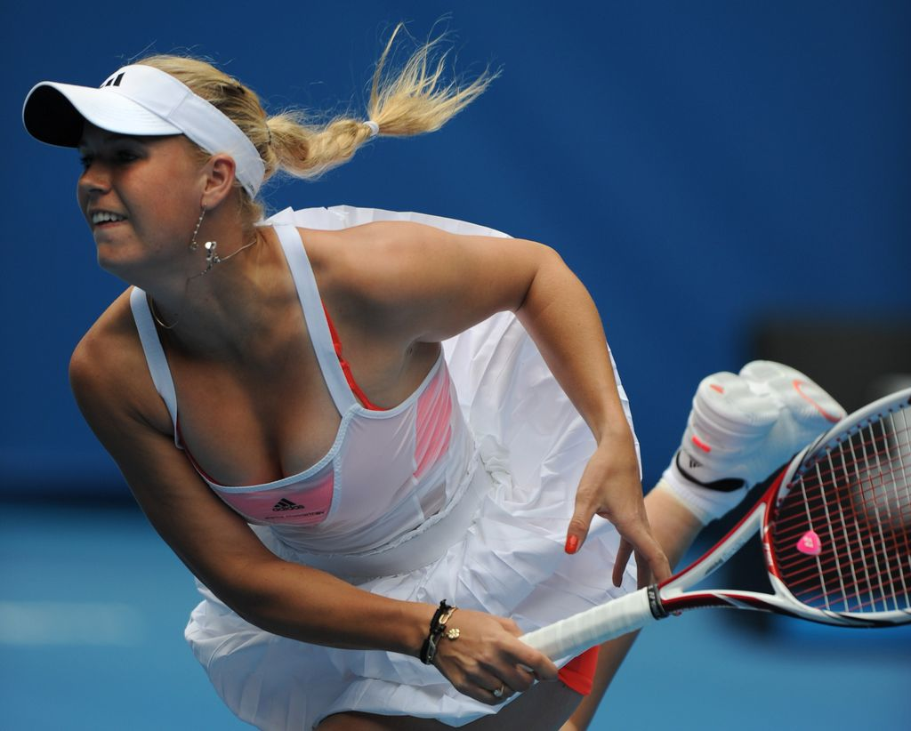 Caroline Wozniacki of Denmark plays a stroke during her women's singles match against Gisela Dulko of Argentina on the first day of the Australian Open tennis tournament. in Melbourne on January 17, 2011. Wozniacki won the first set 6-3, as the match continues. IMAGE STRICTLY RESTRICTED TO EDITORIAL USE ¿ STRICTLY NO COMMERCIAL USE AFP PHOTO/Greg Wood TENNIS-OPEN-AUS