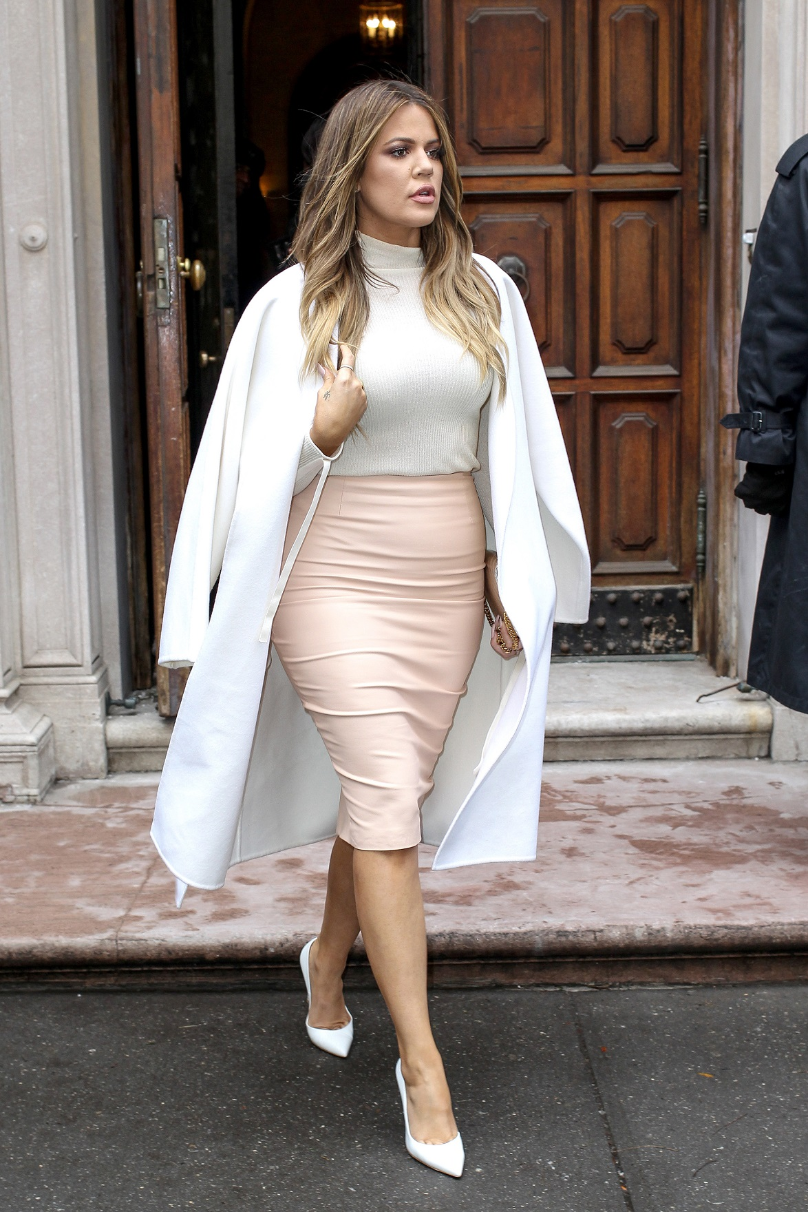 New York, NY - Kardashian sisters Kim and Khloe headed out of an event in NYC on Tuesday, looking amazing while rocking coordinated muted shades. Kim showed off her new cropped 'do while donning a head-to-toe snakeskin ensemble, while Khloe looked pretty in pink in a pale blush-colored pencil skirt, paired with a white trench and white pumps. AKM-GSI February 10, 2015 To License These Photos, Please Contact : Steve Ginsburg (310) 505-8447 (323) 423-9397 steve@akmgsi.com sales@akmgsi.com or Maria Buda (917) 242-1505 mbuda@akmgsi.com ginsburgspalyinc@gmail.com