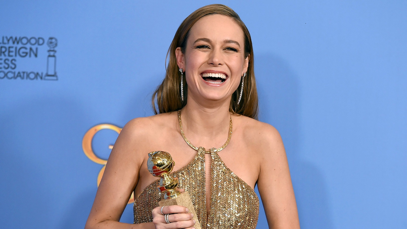 "Brie Larson poses in the press room with the award for best actress in a motion picture - drama for ""Room"" at the 73rd annual Golden Globe Awards on Sunday, Jan. 10, 2016, at the Beverly Hilton Hotel in Beverly Hills, Calif. (Photo by Jordan Strauss/Invision/AP)"